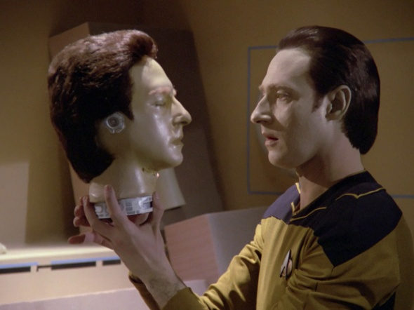 Data wonders why the crew react so oddly when he wears his backup head.